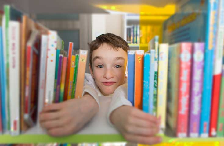 Third Grader, Tim Spear shows excitement at opening of Sunnyside Library