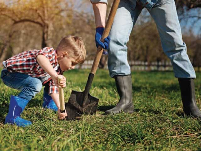 Child helping to dig a hole